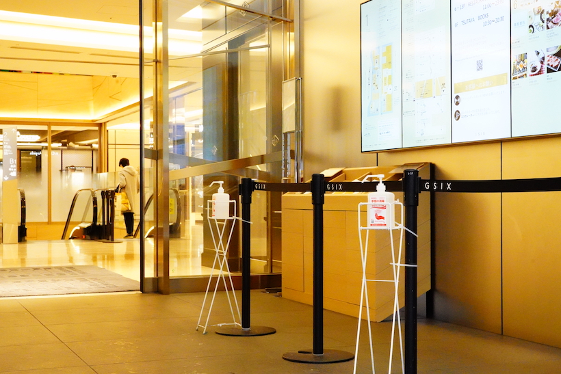 Alcohol sprays are located at the entrance of GINZA SIX to ensure customer's safety